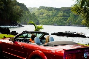Convertible driving along the coast